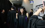 Pre-Ceremony - Graduate Poses for Photo