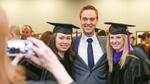 Pre-Ceremony - Three Graduates Pose for Photo